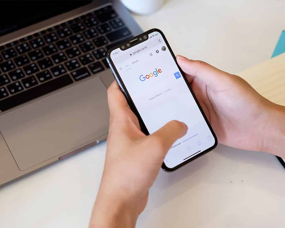 Person doing a google search on their phone