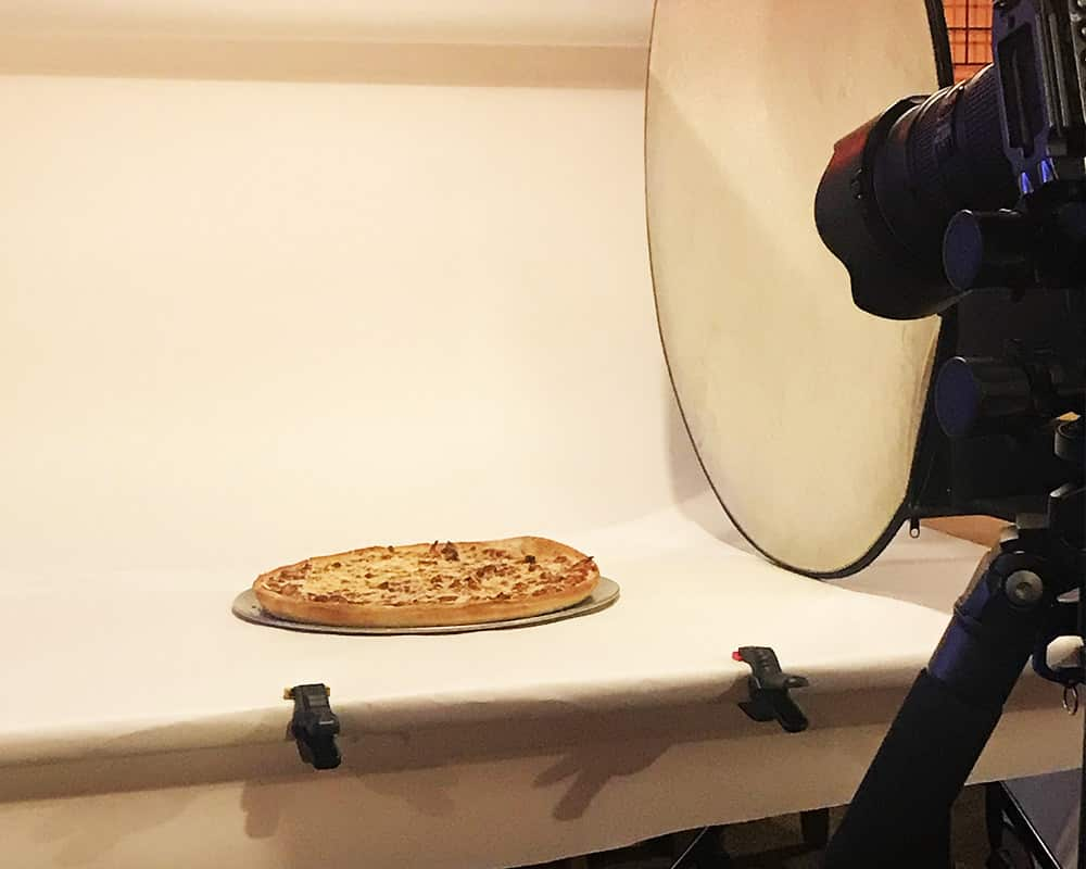 Camera taking a photo of pizza