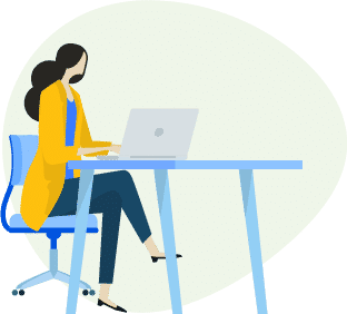 Woman siting at a table with a laptop.